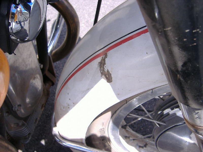 Hole in the front fender.<br /> <br /> One of the horns is visible in the upper left of the photo.  They sound like a horn from a '57 Chevy.  Perfect for lighting up clueless cagers.