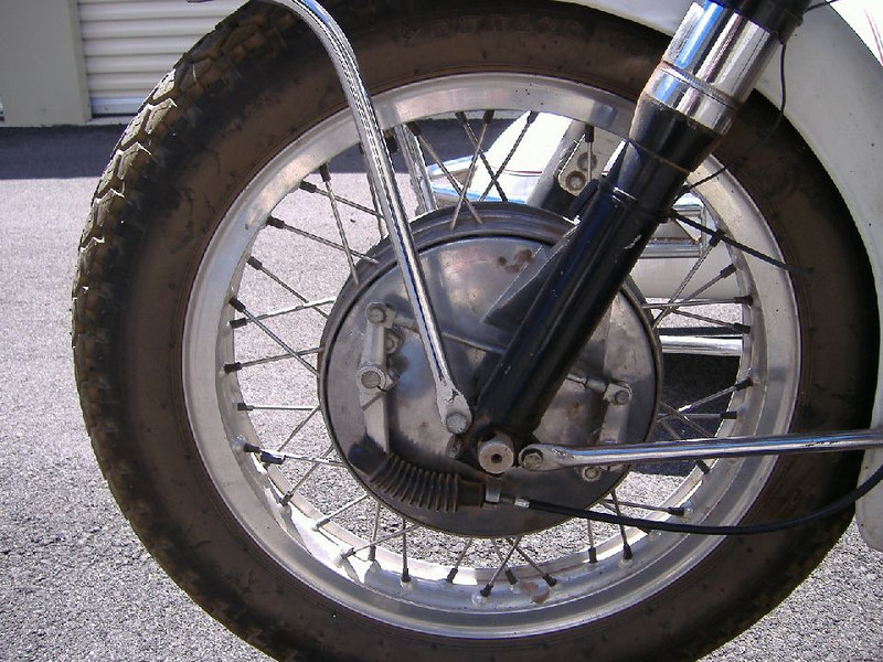 2LS front brake.  New boot, cable, and shoes in '05.  The chrome on the fender stays is in good shape.
