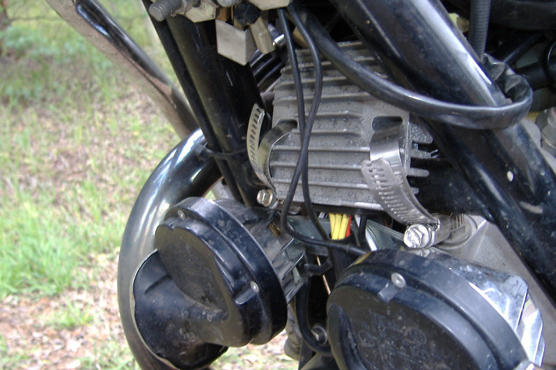 Ugly but functional installation of the new voltage reg/rec. There is enough wire to locate it elsewhere on the bike...imortant that it has plenty of cooling air flow.
