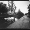 Pinhole on film, along the towpath of a canal, exposure was about 45 seconds, I was trying to get the trails of a barge in the picture but 45 seconds was too long and I was a bit premature and started way too early and as you can just see the barge just about appears in a ghostly fashion.