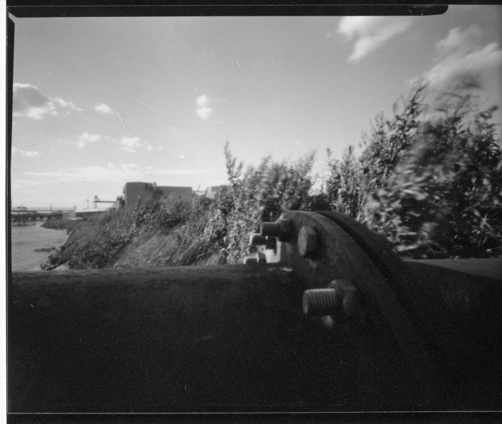 Pinhole on film, rather large rusty pipe, in the background you can see the Tlida rice factory, Rainham and to the left, the River Thames