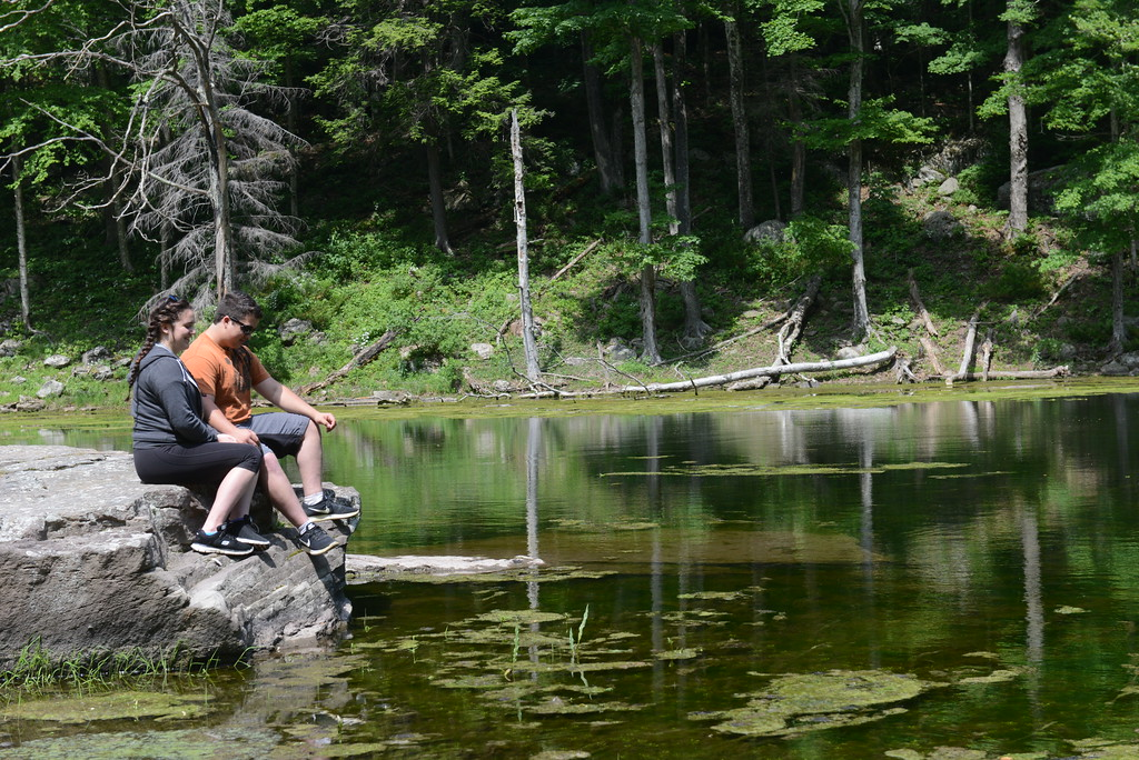 . Emma Baldwin of Willow and Christoff Seivers of Woodstock enjoy a stop at Notch Pond  in the town of Hunter recently.