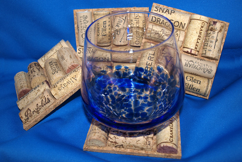 "Corked Coasters by Lora Mosier<br /> <br />  <a href=""http://www.burningriverboutique.com"">http://www.burningriverboutique.com</a>"