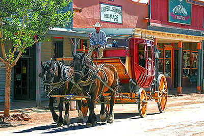 Tombstone, Arizona, has dirt streets and lots of stagecoaches available to tour this old wild west town in style.  Card #177