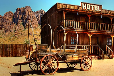 Covered wagon with Superstition Mountain in Apache Junction, Arizona.  Card #157
