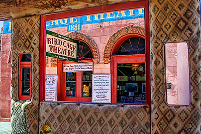 A view of the Birdcage theater from inside a passing stagecoach, Tombstone, Arizona.  Card #174