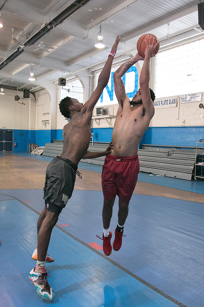 Students at Notre Dame Prep at practice on Tuesday November 8, 2016. Daniel Kiely, 18, goes up for a shot as Melo Eggleson, 18, tries to block the shoot. SENTINEL & ENTERPRISE/JOHN LOVE