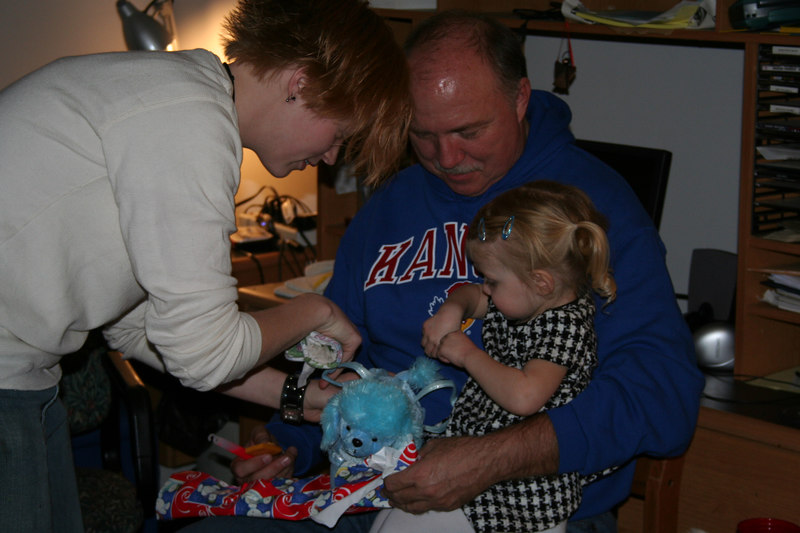 Daddy's Cousin Haley looking at Carolyn's new blue poodle purse