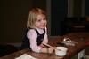 Carolyn helping with the garlic bread