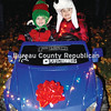 Eli and Evan Gabrys pose with a pretty cool kid-sized Ford F150 pickup truck at Darius Miller Park Friday, near the Princeton Christmas tree that was officially lit for the first time that night.