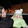 Michelle and Haisley Hansen have fun with a special pair of kid-sized Christmas glasses Friday night at the lighting of the city's Christmas tree in Darius Miller Park.