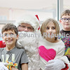 Santa visited with (from left) Alexander Nally, 8, Keeley McCarter, 9, and Kannon McCarter, 8, during his weekend stint at the Prouty Building.