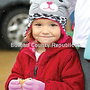 Taryn Hill, 3, of Wyanet nibbles on s'mores that were preparedoutside the Open Prairie UCC Church's Christkindl Market.