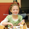 Lilith Gray, 9, of Princeton makes a gingerbread house at Saturday's Christkindl Market during the Princeton Christmas Walk.