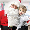 Wyatt Vladika, 4, of Princeton gets a hug from Santa Claus, who spent parts of Saturday and Sunday greeting children, and the young at heart, at Princeton's Prouty Buiding.