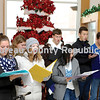 The Princeton High School Madrigal Singers entertained people at the Prouty Building with holiday songs during the Christmas Walk Saturday.
