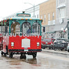 """Princeton's trolley car makes its way through the snowflakes that fell Saturday during Princeton's Christmas Walk, """"Miracle on Main Street."""""""