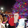 Surrounded by kids in front of the just-lit city of Princeton Christmas tree, Santa Claus visits with his young fans Friday evening at Darius Miller Park.