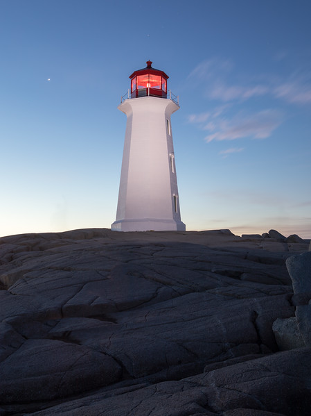 Sunrise at Peggy's Cove Lighthouse , Nova Scotia ( Lighthouse was freshly painted about a week before this picture taken )
