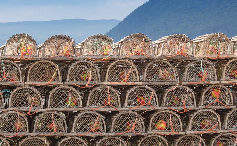 Lobster Traps stored along shore of St Ann Harbour on Cape Breton
