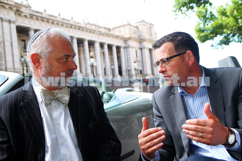 21-11-14. State Oppostion leader Daniels Andrews talking with ZCV president Sam Tatarka opposite Parliament House. Andrews explaining the oppostions pledge of a grant to up grade security at the beth Weizmann Community Centre if they win the state election. Photo: Peter Haskin