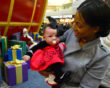 11/19/2016 Mike Orazzi | Staff Onderigha Singletary and her two month old daughter Breighlyn Davis while visiting Santa at the West Farms Mall on Saturday.