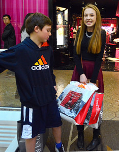11/19/2016 Mike Orazzi | Staff Jacob and Amanda Greco while waiting for their parents during some Christmas shopping at the West Farms Mall on Saturday.