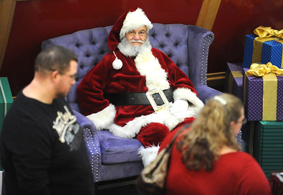 11/19/2016 Mike Orazzi | Staff Santa waits for visitors at the West Farms Mall on Saturday.