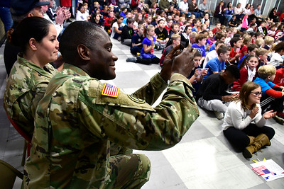 11/10/2016 Mike Orazzi | Staff Jimmy Smith shotos a photo during the Edgewood School's Veterans Day program in Bristol Thursday morning.