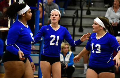 11/10/2016 Mike Orazzi | Staff Bristol Eastern's Sienna White (9), Aliana Rivoira (21), and Jessica Kenney (13) during the Class L Second Round State Girls Volleyball Tournament at Bristol Eastern Thursday night.