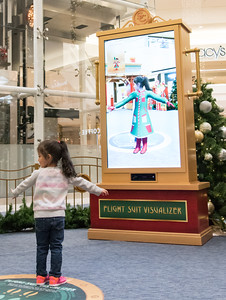 111016  Wesley Bunnell | Staff  Luz Sofia Valentin, age 3, poses for her interactive flight suit during Santa's Flight Academy at the Westfarms Mall on Thursday afternoon.
