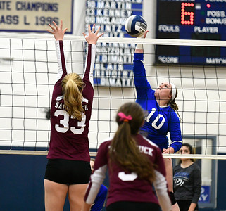 11/10/2016 Mike Orazzi | Staff Naugatuck's Emma Healy (33) and Bristol Eastern's Mikayla Martin (10) during the Class L Second Round State Girls Volleyball Tournament at Bristol Eastern Thursday night.