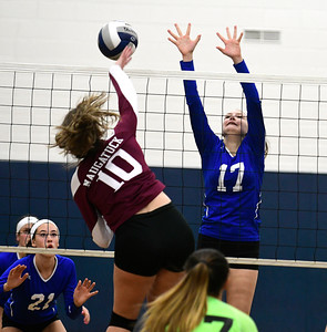 11/10/2016 Mike Orazzi | Staff Naugatuck's Olivia Rotatori (10) and Bristol Eastern's Gabriella Nozzolillo (17) during the Class L Second Round State Girls Volleyball Tournament at Bristol Eastern Thursday night.