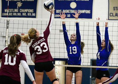11/10/2016 Mike Orazzi | Staff Naugatuck's Emma Healy (33) and Bristol Eastern's Amber Blais (19) and Olivia Beaudoin (4) during the Class L Second Round State Girls Volleyball Tournament at Bristol Eastern Thursday night.