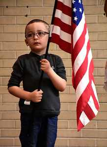 11/10/2016 Mike Orazzi | Staff Derrick Santos during Pledge of Allegiance of the United States at the Edgewood School's Veterans Day program in Bristol Thursday morning.