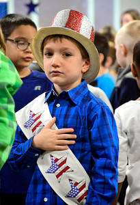 11/10/2016 Mike Orazzi | Staff Christian Ferraro during the Pledge of Allegiance of the United States at the Edgewood School's Veterans Day program in Bristol Thursday morning.