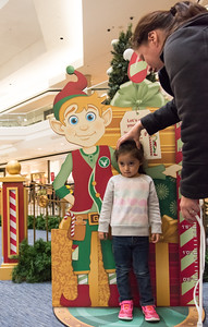 111016  Wesley Bunnell | Staff  Luz Sofia Valentin, age 3, has her height checked by mom Nidia Caraballo during Santa's Flight Academy at the Westfarms Mall on Thursday afternoon.