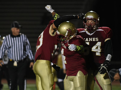 111016  Wesley Bunnell | Staff  New Britain football vs Enfield on Thursday night. Senior RB/DB Keyon Wellington #4 with a touchdown and celebration with teammate