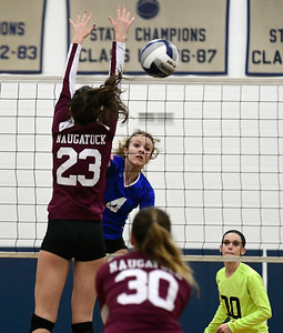 11/10/2016 Mike Orazzi | Staff Naugatuck's Taylor Hyde (23) and Bristol Eastern's Olivia Beaudoin (4) during the Class L Second Round State Girls Volleyball Tournament at Bristol Eastern Thursday night.