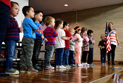11/10/2016 Mike Orazzi | Staff The Pledge of Allegiance of the United States at the Edgewood School's Veterans Day program in Bristol Thursday morning.