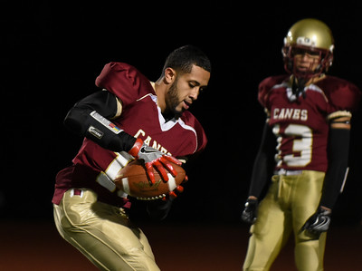 111016  Wesley Bunnell | Staff  New Britain football vs Enfield on Thursday night. Senior WR/DB Romeo Lozada #18 practicing during the half.