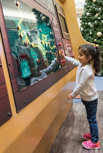111016  Wesley Bunnell | Staff  Luz Sofia Valentin, age 3, picks which route Santa should take during Santa's Flight Academy at the Westfarms Mall on Thursday afternoon.