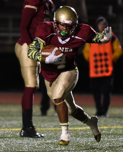 111016  Wesley Bunnell | Staff  New Britain football vs Enfield on Thursday night. Senior RB/DB Keyon Wellington #4 with a touchdown run in the 3rd quarter.