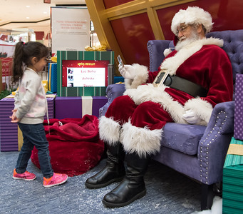 111016  Wesley Bunnell | Staff  Luz Sofia Valentin, age 3, receives a small toy for being good at the conclusion of Santa's Flight Academy at the Westfarms Mall on Thursday afternoon.