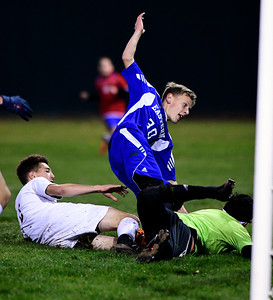 11/1/2016 Mike Orazzi | Staff Bristol Eastern's Jake Woznicki (30) scores and early goal during boys soccer at Muzzy Field Tuesday night.