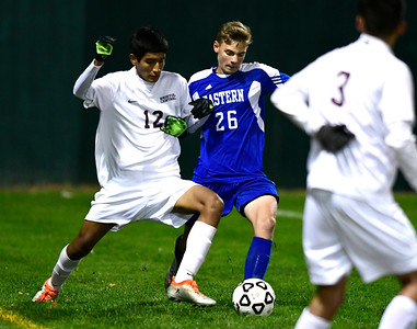 11/1/2016 Mike Orazzi | Staff Bristol Central's Jonathan Cabrera (12) and Bristol Eastern's Jeremy Mosieur (26) during boys soccer at Muzzy Field Tuesday night.