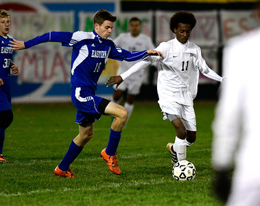 11/1/2016 Mike Orazzi | Staff Bristol Eastern's Jared Greger (16) and Bristol Central's Marcello DelValle (11) during boys soccer at Muzzy Field Tuesday night.