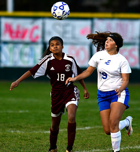 11/1/2016 Mike Orazzi | Staff Bristol Central's Amanda Carlucci (18) and Bristol Eastern's Brooke Dauphinee (19) at Muzzy Field Tuesday evening.