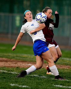 11/1/2016 Mike Orazzi | Staff Bristol Eastern's Myah Croze (9) and Bristol Central's Meghan Hamel (15) at Muzzy Field Tuesday evening.