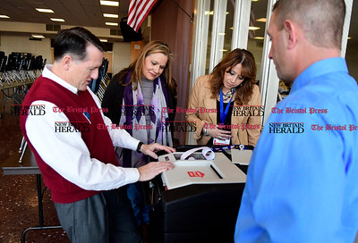 11/1/2016 Mike Orazzi | Staff Democratic Registrar of Voters Kevin McCauley tallies votes as Janet Mulcahy and Claudia George and Ryan Broderick look on during the mock election held at Bristol Central High School Tuesday.